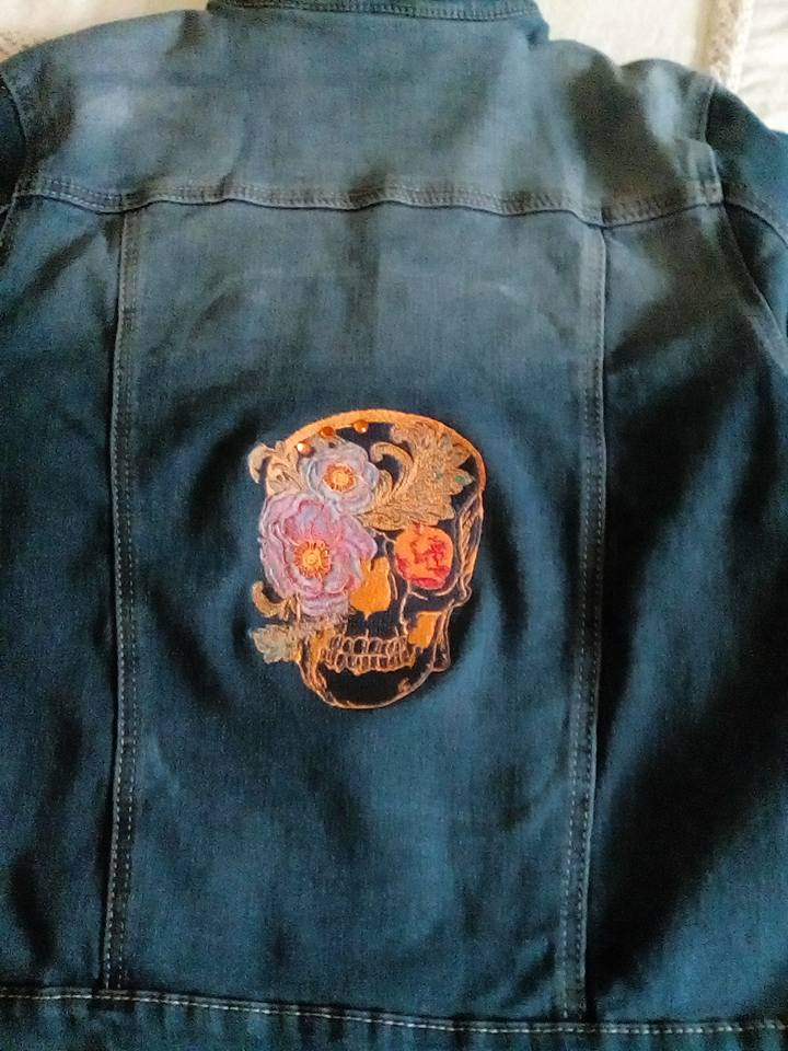 Embroidered denim jacket with Skull design