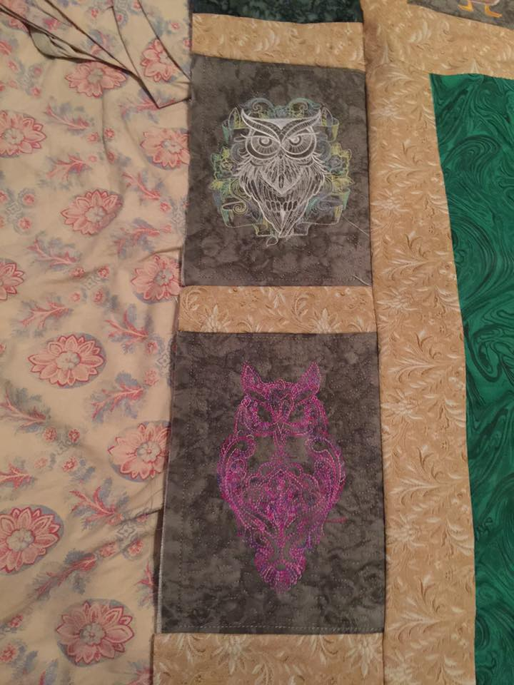 Embroidered quilt with owls