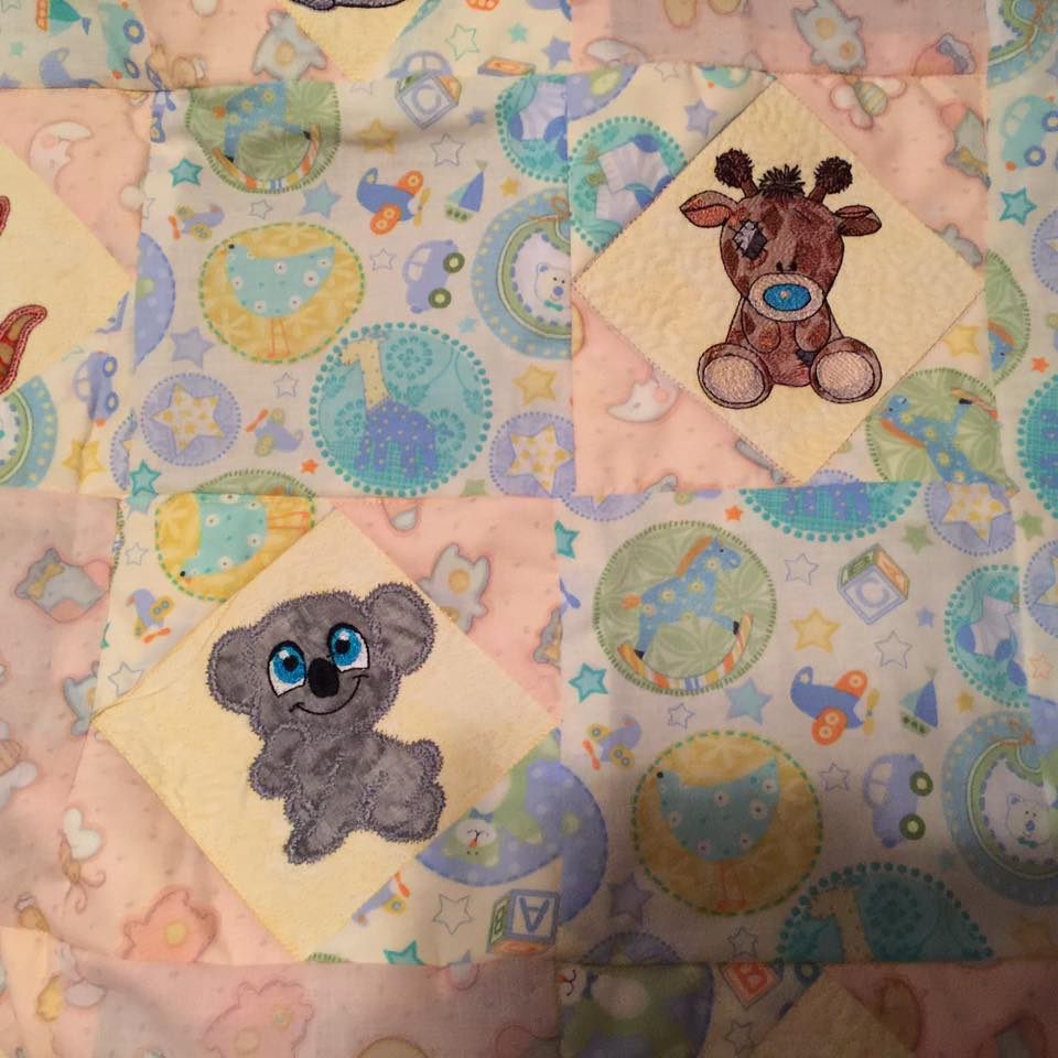 Twiggy Giraffe and koala embroidered on baby quilt