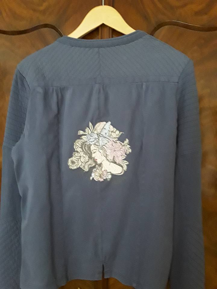 Woman's jacket with fashionable girl embroidery design