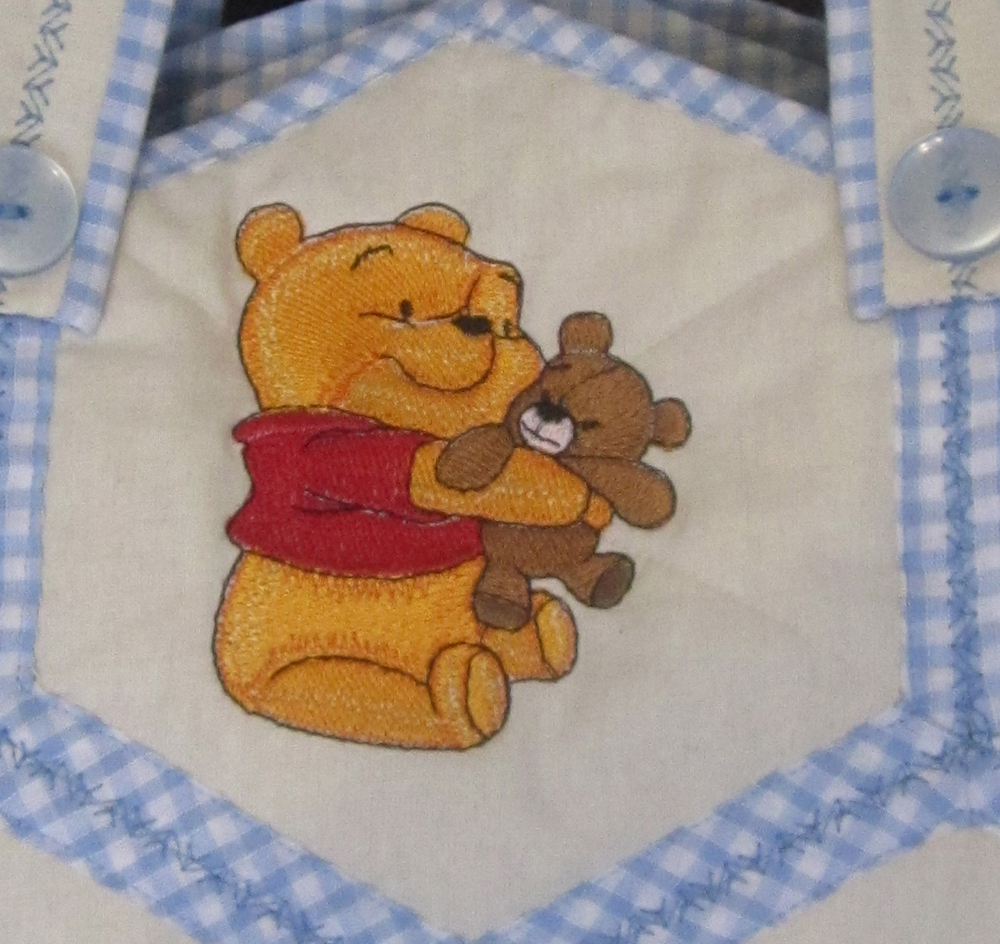Nappy bag embroidered with baby Pooh playing with teddy bear design