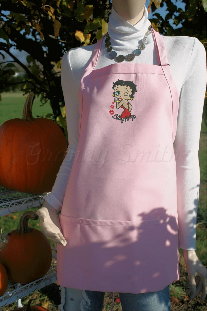 Embroidered pink apron with Betty Boop on it
