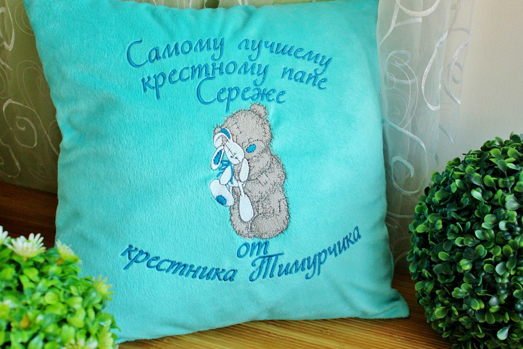 Blue pillowcase embroidered with blue nose teddy bear design