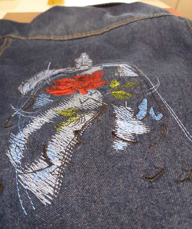Embroidered women denim jacket with rose design