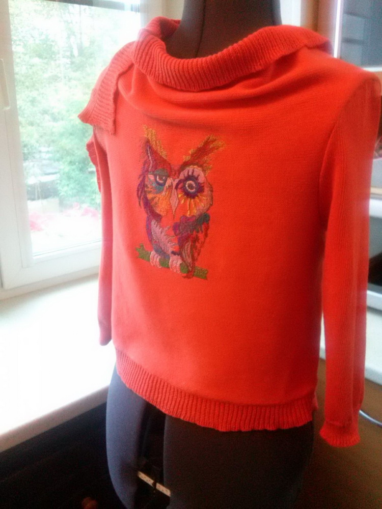 Orange sweater embroidered with strange owl