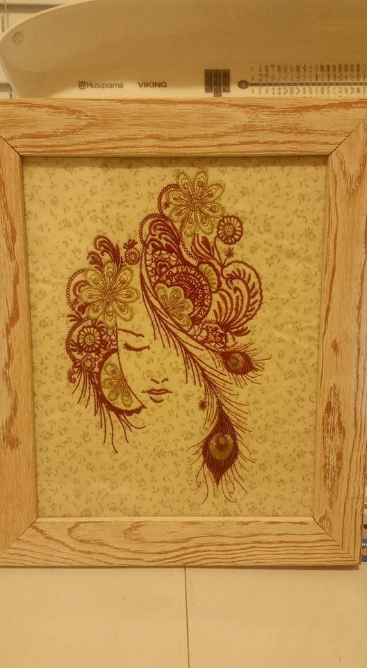 Framed firebird embroidery design