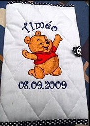 Happy Winnie Pooh embroidered on white cover