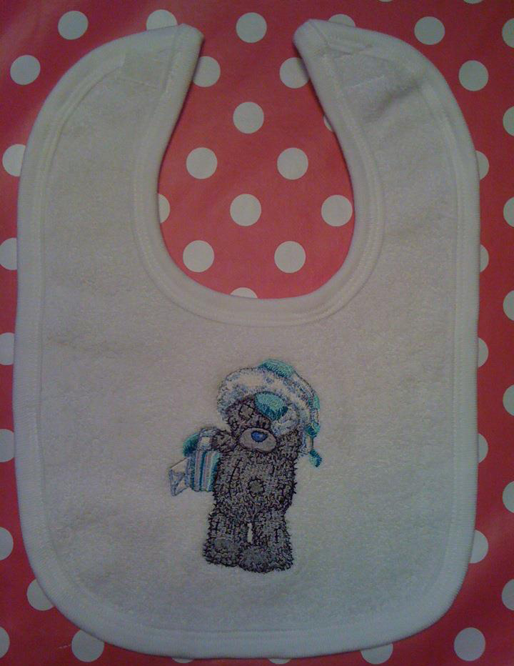 Baby bib embroidered with winter mail design