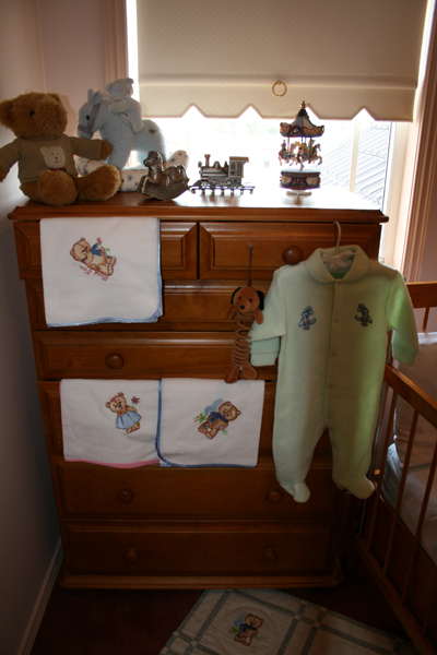 Romper and towels embroidred with teddy bears and bunny designs