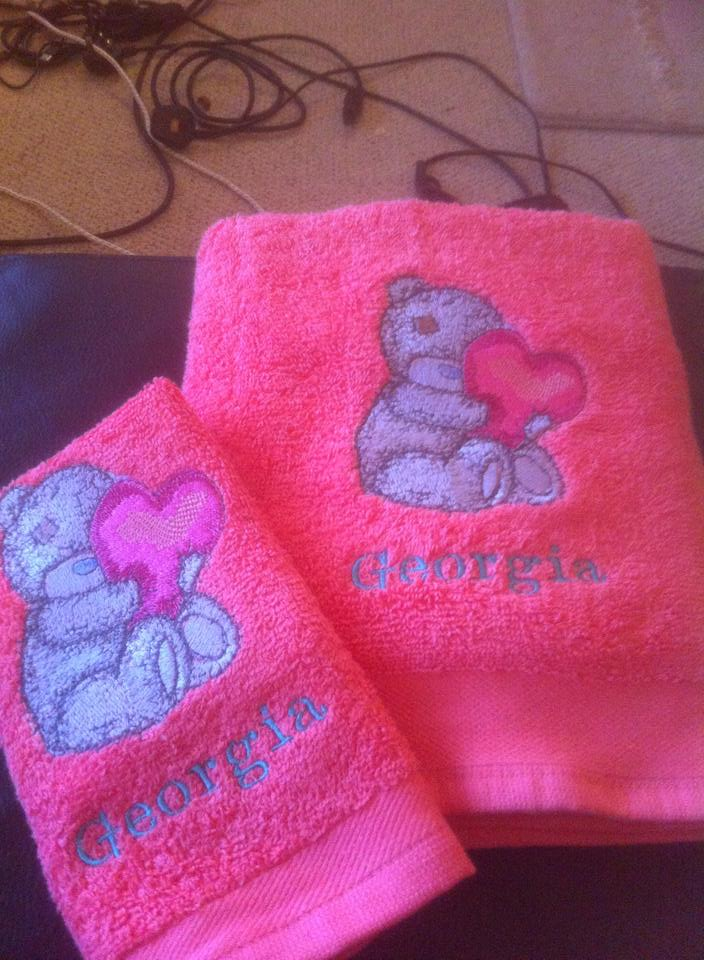 Cute teddy bear embroidered on pink bath towels
