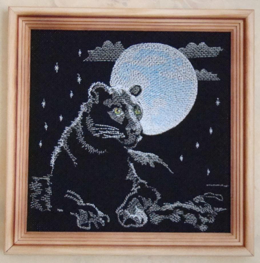 Embroidered panther in frame