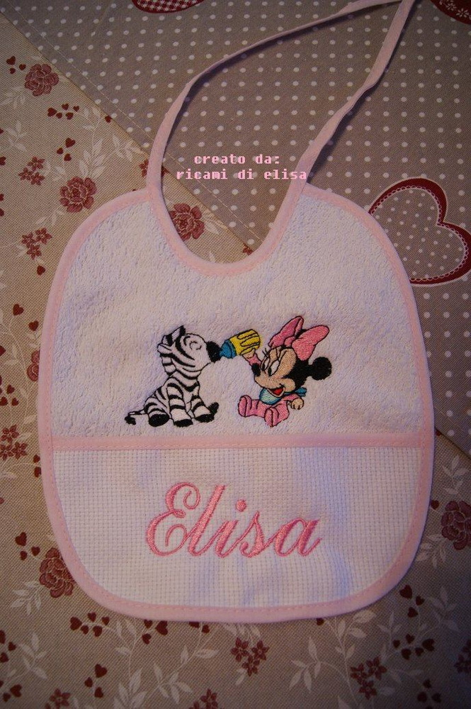 Minnie Mouse and zebra on embroidered bib