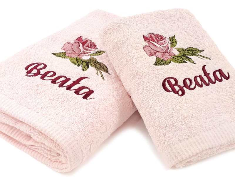 Towels with rose embroidery design
