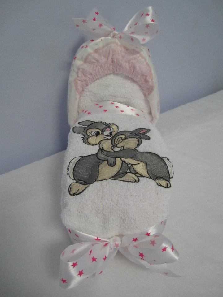 Cute small bunnies on embroidered newborn gift