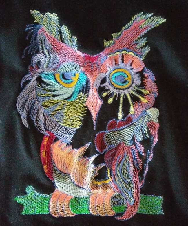 Embroidered in black fabric owl design