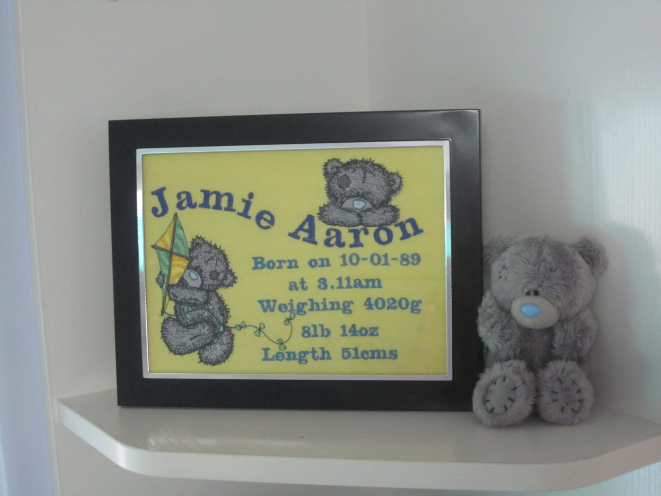 Teddy bear designs embroidered on birth announcement frame