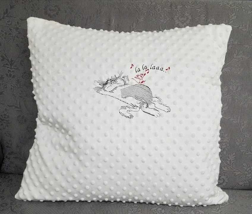Embroidered sofa cushion with sleeping cat design