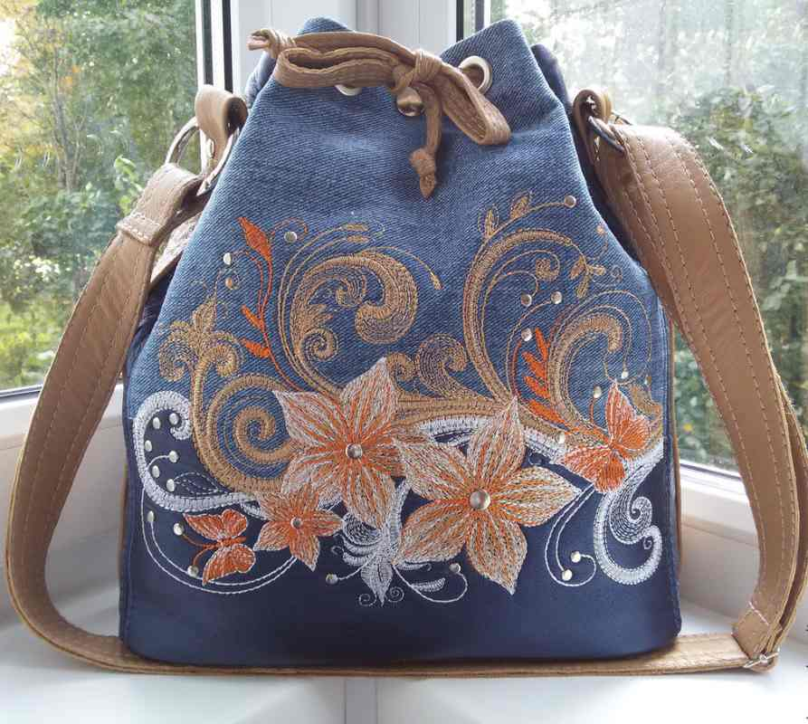 Denim bag with floral embroidery design