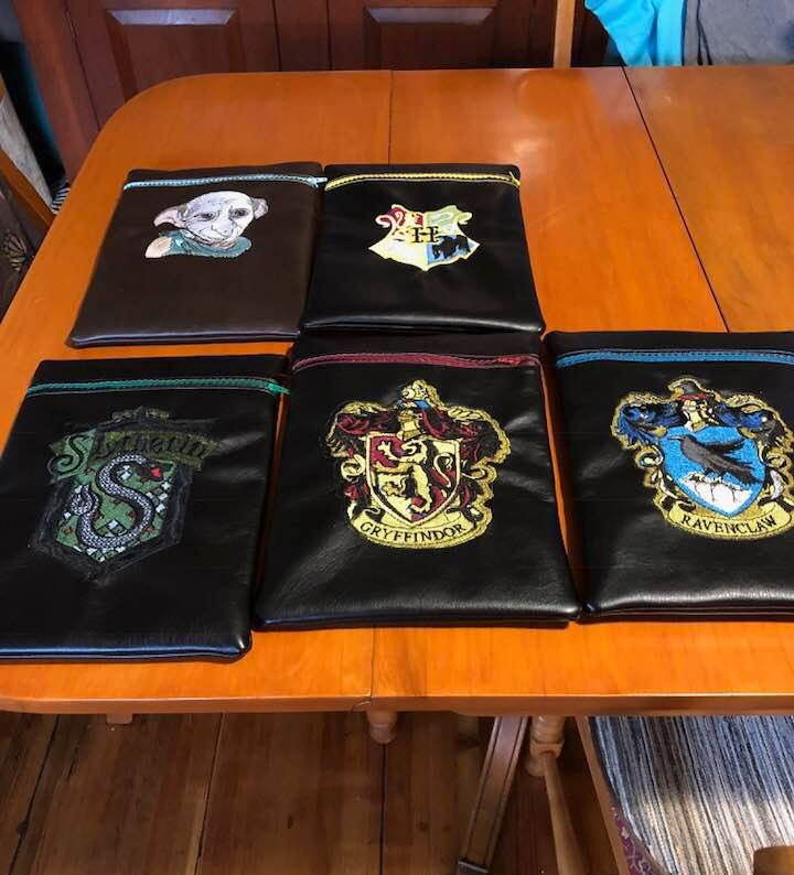 Embroidered leather case with Harry Potter designs