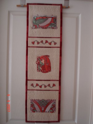 Embroidered quilt with egyptian designs