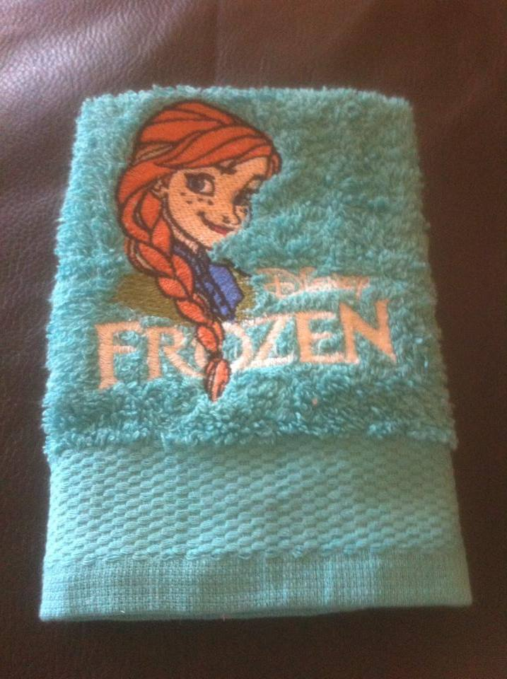 Green towel with Anna embroidered on it