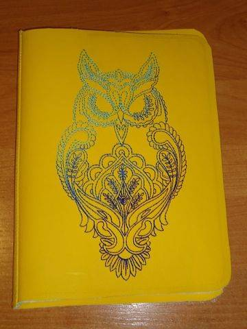 Owl design embroidered on cover