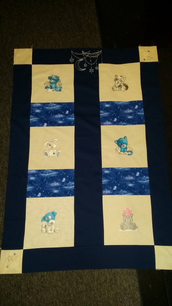 Embroidered blanket with tatty teddy and blue nose friends