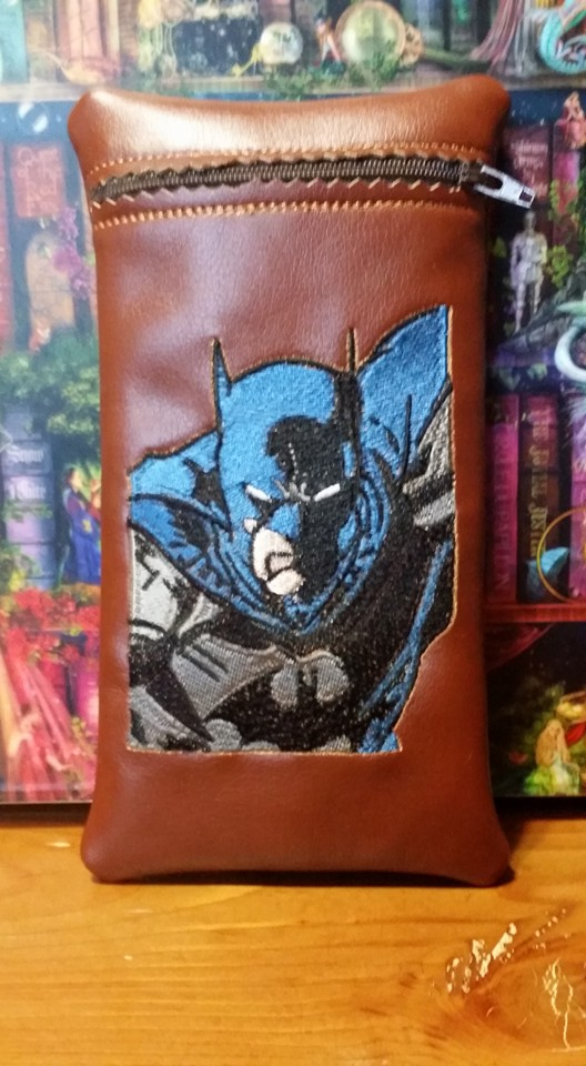 Embroidered Batman never sleeps design on small black leather bag
