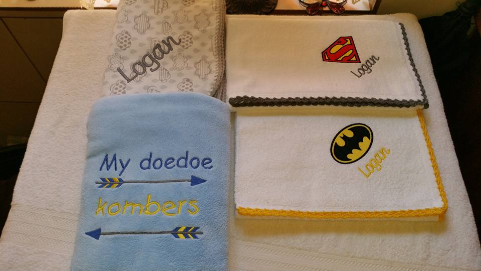 Towels with Superman and Batman logo embroidery design