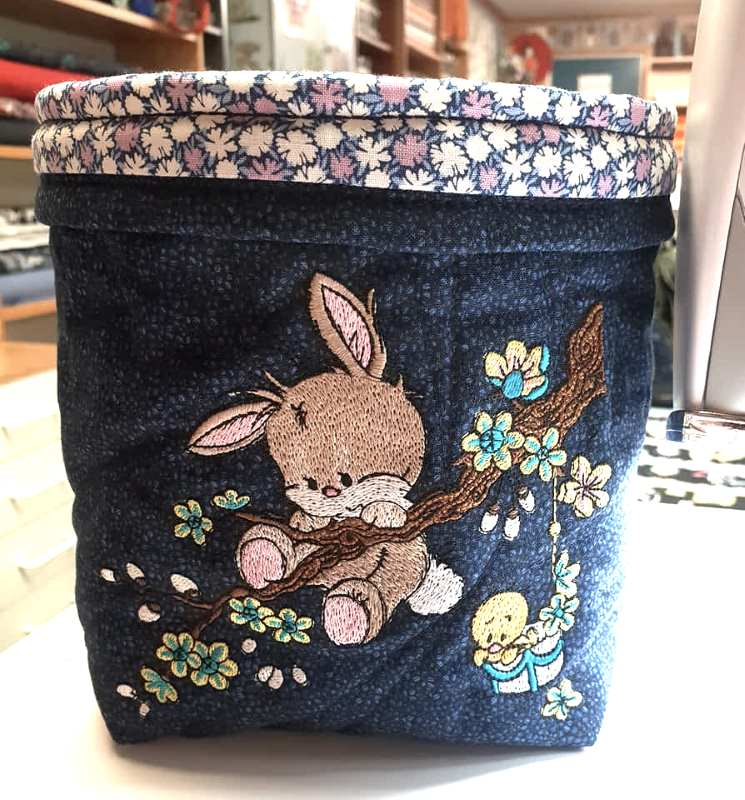 Embroidered basket with bunny design