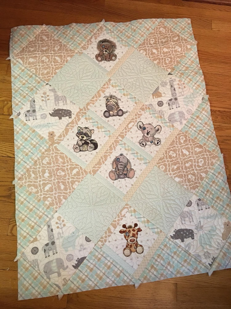 Baby quilt with embroidered cute blue nose friends