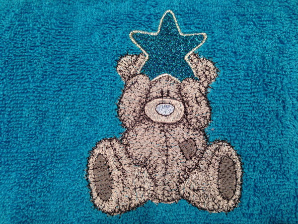 Bath towel embroidered with teddy bear design