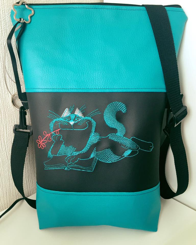 Cat like read book design on bag embroidered