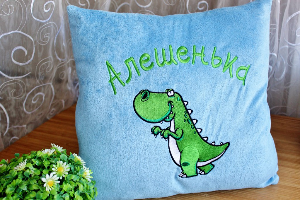 cushion with dinosaur embroidery design