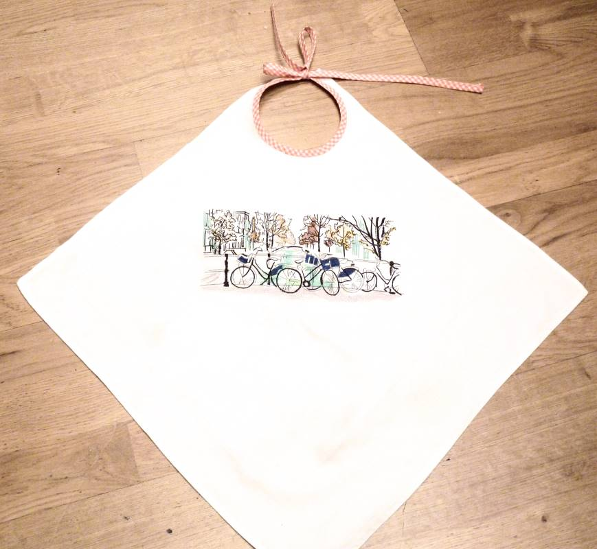 Embroidered baby bibs with bicycle travel design