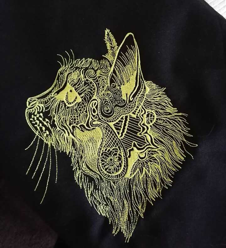 Embroidered fancy cat design