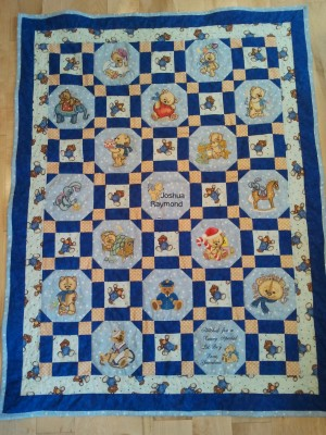 Colorful embroidered quilt with old toys designs