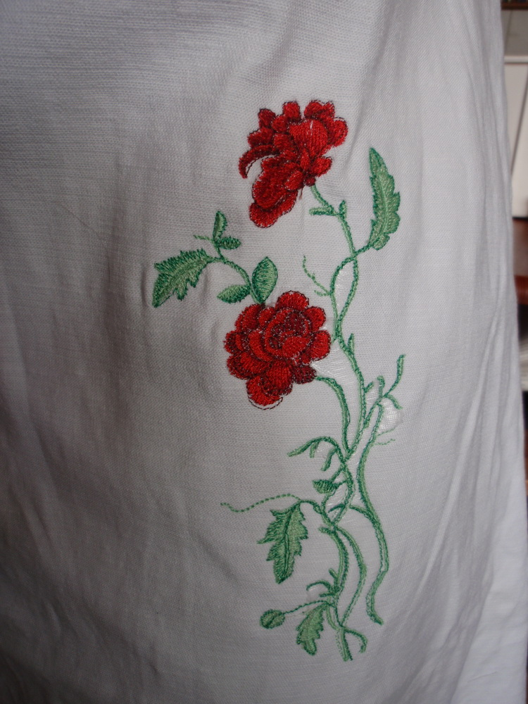 Wonderful red rose embroidered on summer dress