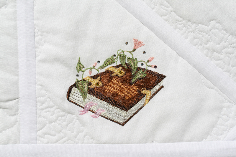 Magic book design on embroidered blanket
