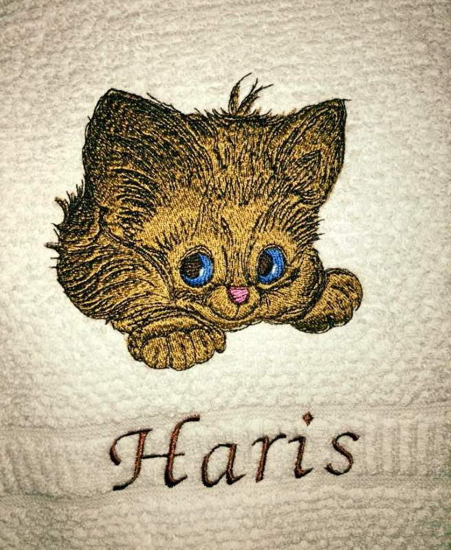Bathroom towel with kitten embroidery design