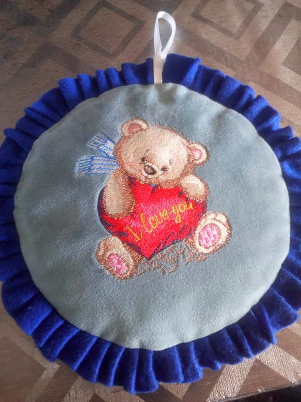 Embroidered newborn gift with teddy bear heart design