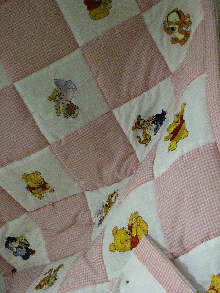Girlish quilt with Wiinie the Pooh designs embroidered