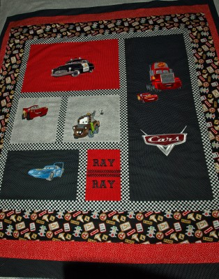 Cars designs embroidered on colorful quilt