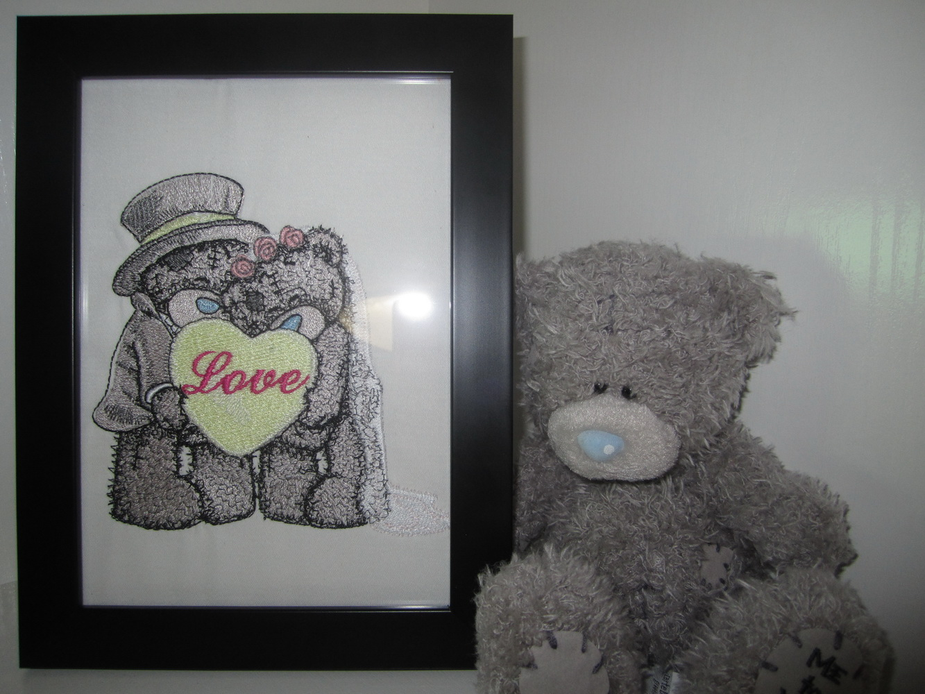 Blue nose bride and groom in frame embroidered