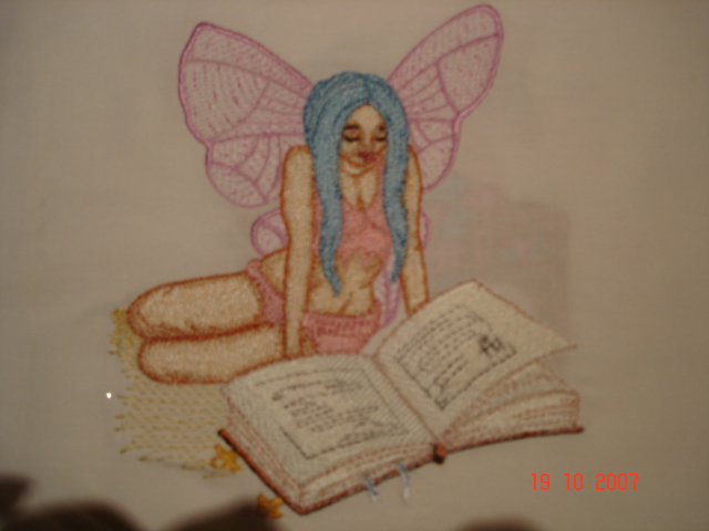Fairy reading a book design embroidered