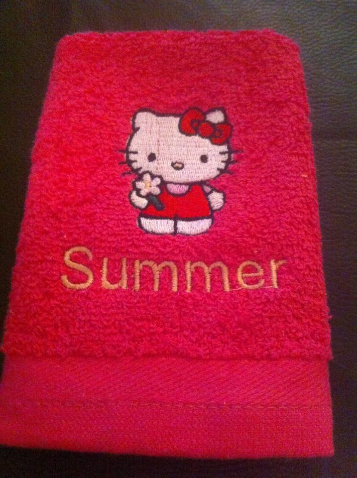 Hello Kitty Good Day design on towel embroidered