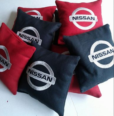 Embroidered Nissan logo on pillowcase