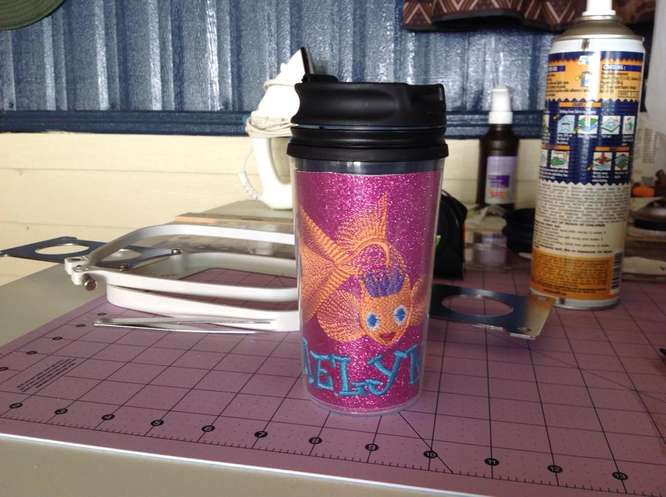 Embroidered cup cover with free embroidery