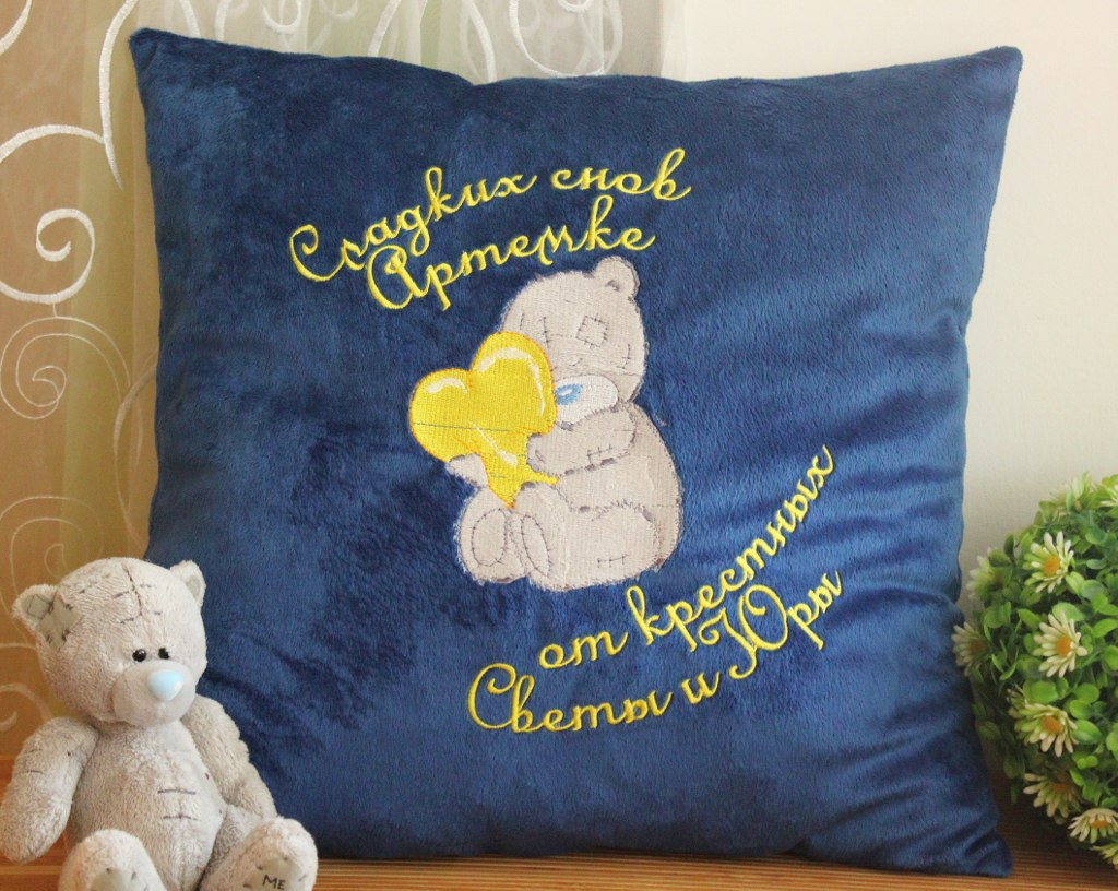 Teddy Bear with a pillow heart design on embroidered pillowcase