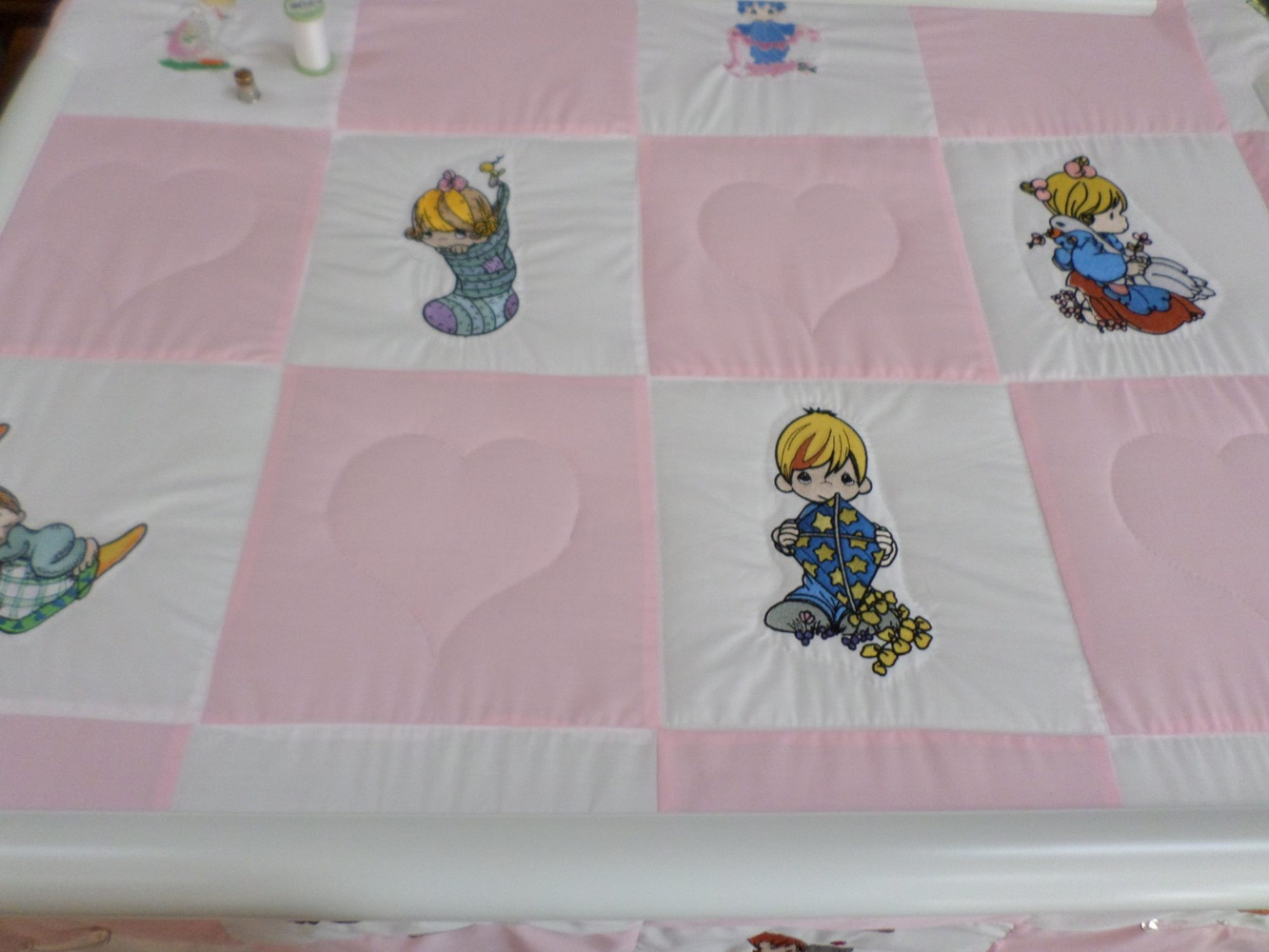 Precious Moments embroidery designs on quilt